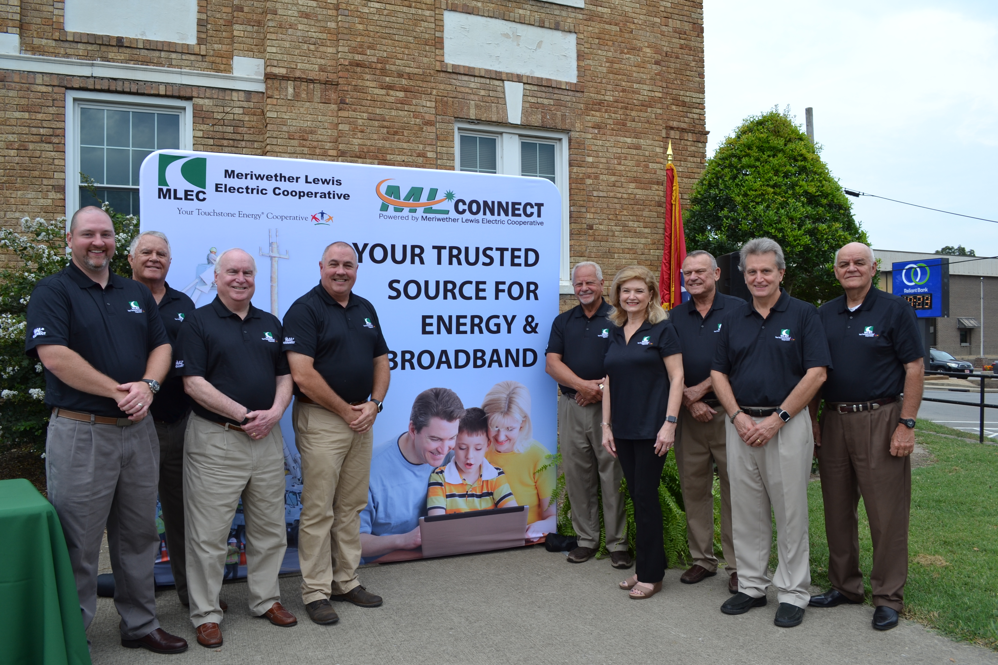 Meriwether Lewis Electric Cooperative officials with Your Trusted Source For Energy and Broadband back-drop.